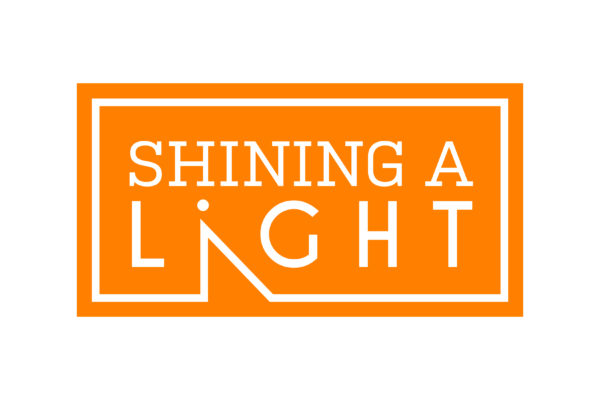 shining a light logo